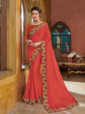 marvelously charming is what you will look at the next wedding gala wearing this beautiful orange color two tone bright georgette saree. Ideal for party, festive & social gatherings. this gorgeous saree featuring a beautiful mix of designs. Its attractive color and heavy designer embroidered saree, full saree design saree, stone designs, beautiful floral design all over work over the attire & contrast hemline adds to the look. Comes along with a contrast unstitched blouse.