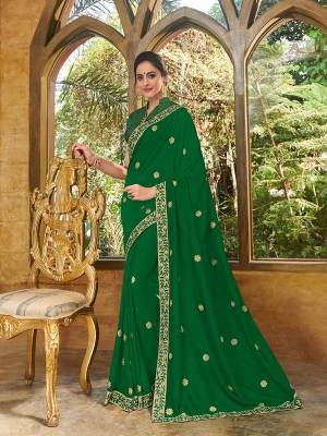 Vibrant and visually appealing, this green color silk fabrics saree. Ideal for party, festive & social gatherings. this gorgeous saree featuring a beautiful mix of designs. Its attractive color and heavy designer embroidered saree, full saree design saree, beautiful floral design all over work over the attire & contrast hemline adds to the look. Comes along with a contrast unstitched blouse.