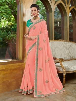 Look your ethnic best by wearing this Peach color silk fabrics saree. Ideal for party, festive & social gatherings. this gorgeous saree featuring a beautiful mix of designs. Its attractive color and heavy designer embroidered saree, full saree design saree, beautiful floral design all over work over the attire & contrast hemline adds to the look. Comes along with a contrast unstitched blouse.