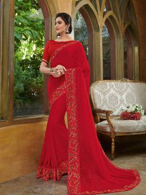 Look gorgeous in this beautiful printed red color georgette saree. Ideal for party, festive & social gatherings. this gorgeous saree featuring a beautiful mix of designs. Its attractive color and heavy designer embroidered saree, stone design, sequence designs, beautiful floral design all over work over the attire & contrast hemline adds to the look. Comes along with a contrast unstitched blouse.
