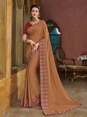 The fabulous pattern makes this saree a classy number to be included in your wardrobe. Beige color two tone bright chiffon saree. Ideal for party, festive & social gatherings. this gorgeous saree featuring a beautiful mix of designs. Its attractive color and heavy designer embroidered saree, full saree design saree, sequence designs, beautiful floral design all over work over the attire & contrast hemline adds to the look. Comes along with a contrast unstitched blouse.