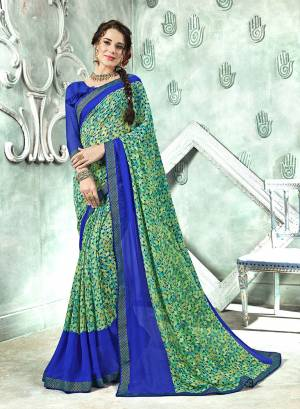 Add Some Casuals With This Saree In Green Color Paired With Contrasting Royal Blue Colored Blouse. This Saree And Blouse Are Georgette Based Beautified With prints All Over. Buy Now.