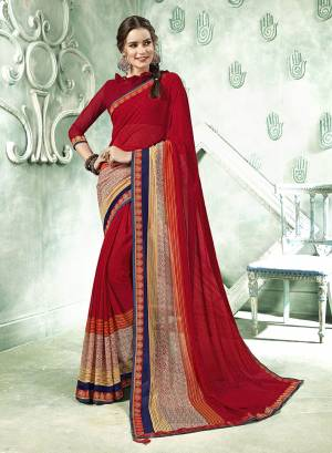 Simple Saree Is Here For Your Casual Wear In Red Color Paired With Red Colored Blouse. This Saree And Blouse Are Fabricated On Georgette Beautified With Prints And lace Border.
