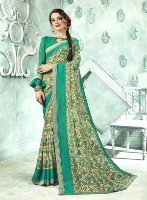 Here Is A Pretty Green Colored Printed Saree Paired With Green Colored Blouse. This Saree And Blouse Are Fabricated On Georgette Which Is Light In Weight And Easy To Carry All Day Long.