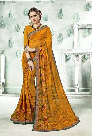 Traditional Color Is Here With This Saree In Musturd Yellow Color Paired With Musturd Yellow Colored Blouse. This Saree And Blouse Are Georgette Based Beautified With Prints And Lace Boder.