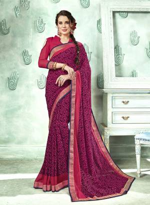 Bright And Appealing Color Is Here With This Saree In Dark Pink Color Paired With Dark Pink Colored Blouse. This Saree And Blouse are Georgette Based Beautified With Prints And Lace Border. Its Fabrics Ensures Superb Comfort All Day Long.