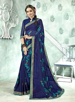 Simple Saree Is Here For Your Casual Wear In Navy Blue Color Paired With Navy Blue Colored Blouse. This Saree And Blouse Are Fabricated On Georgette Beautified With Prints And lace Border.