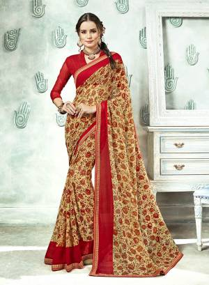 Traditional Color Is Here With This Saree In Cream Color Paired With Red Colored Blouse. This Saree And Blouse Are Georgette Based Beautified With Prints And Lace Boder.