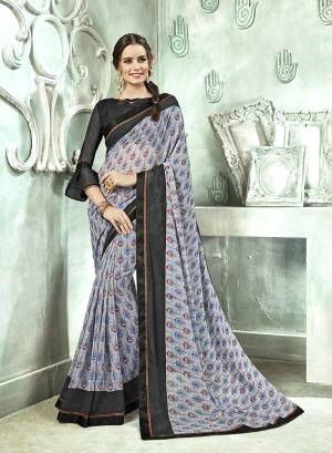 Add Some Casuals With This Saree In Grey Color Paired With Black Colored Blouse. This Saree And Blouse Are Georgette Based Beautified With prints All Over. Buy Now.