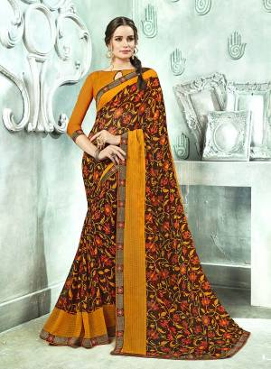 Simple Saree Is Here For Your Casual Wear In Brown Color Paired With Musturd Yellow Colored Blouse. This Saree And Blouse Are Fabricated On Georgette Beautified With Prints And lace Border.