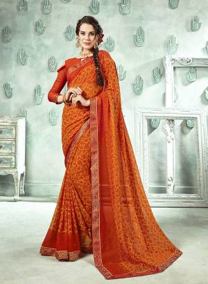 Traditional Color Is Here With This Saree In Orange And Yellow Color Paired With Orange Colored Blouse. This Saree And Blouse Are Georgette Based Beautified With Prints And Lace Boder.