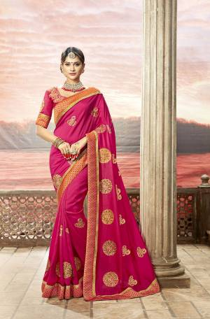 Shine Bright Wearing This Designer Saree In Rani Pink Color Paired With Rani Pink Colored Blouse. This Saree Is Fabricated On Soft Silk Paired With art Silk Fabricated Blouse. It Is Beautified With Jari Embroidery And Stone With Attractive Lace Border.