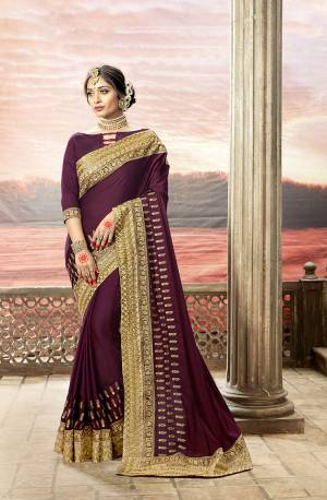 Add This Trending Shade To Your Wardrobe With This Designer Saree In Wine Color Paired With Wine Colored Blouse. This Saree Is Fabricated On Satin Silk Paired With Art Silk Fabricated Blouse. It Has Simple And Elegant Looking Embroidery.