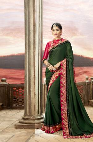 Bright And Visually Appealing Color Is Here With This Designer Saree In Dark Green Color Paired With Contrasting Dark Pink Colored Blouse. This Saree Is Fabricated On Satin Georgette Paired With Art Silk Fabricated Blouse.Both The Fabrics Ensures Superb Comfort All Day Long.