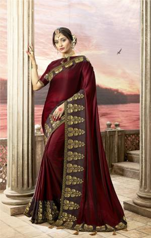 For A Royal Look, Grab This Designer Saree In Maroon Color Paired With Maroon Colored Blouse. This Is Satin Silk Based Paired With Art Silk Fabricated Blouse. It Is Easy To Drape And Durable. Buy This Designer Saree Now.