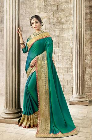 Simple And Elegant Patterned Designer Saree Is Here In Blue Color Paired With Blue Colored Blouse. This Saree Is Satin Silk Based Paired With Art Silk Fabricated Blouse. It Has Heavy Embroidered Lace Border Giving It An Attractive Look.