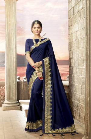 Enhance Your Personality Wearing This Designer Saree In Navy Blue Color Paired With Navy Blue Colored Blouse. This Saree And Blouse Are Silk based Beautified With Attractive embroidered Lace Border.