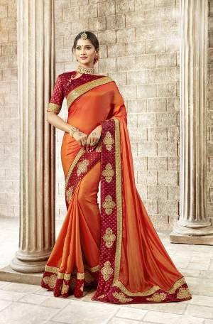 Celebrate This Festive Season With Traditional Color Pallete With This Desigfner Saree In Orange Color Paired With Contrasting Red Colored Blouse. This Saree Is Satin Silk Fabricated Paired With Art Silk Fabricated Blouse. It Is Light In Weight And Easy To Carry All Day Long.