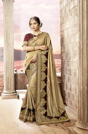 Flaunt Your Rich And Elegant Taste Wearing This Saree In Beige Color Paired With Maroon Colored Blouse. This Saree Is Fabricated On Satin Georgette Paired With Art Silk Fabricated Blouse. Buy This Saree Now.