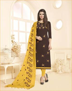 Enhance Your Personality Wearing This Brown Colored Top Paired With Contrasting Yellow Colored Bottom And Dupatta. This Dress Material Is Cotton based Paired With Chanderi Fabricated Dupatta.