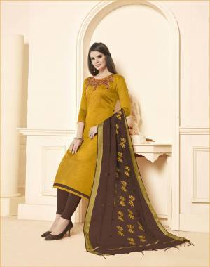Unqiue Color Pallete Is Here With This Dress Material In Musturd Yellow Colored Top Paired With Contrasting Brown Colored Bottom And Dupatta. Its Top and Bottom Are Cotton Based Paired With Chanderi Dupatta.