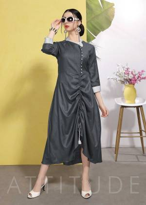 Flaunt Your Rich And Elegant Taste Wearing This Designer Readymade Kurti In Dark Grey Color Fabricated On Wrinkle Free Cotton. This Kurti Has New And Unique Pattern Which Earn You Lots Of Compliments From Onlookers.