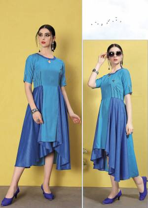 Grab This Designer Readymade Asymetric Patterned Kurti In Blue Color. This Kurti In Wrinkle Free Cotton Based . Its Fabric Ensures Superb Comfort All Day Long.