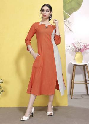 For Your Casual Or Semi-Casual Wear, Grab This Designer Readymade Kurti In Orange And White Color Which Is Cotton based. This Kurti Is Available In All Regular Sizes.