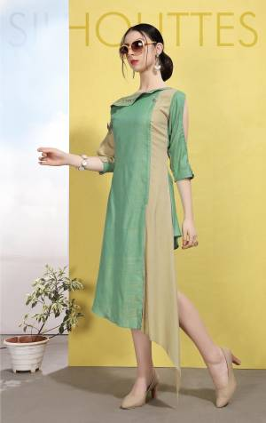 Enhance Your Personality Wearing This Designer Readymade Kurti In Green And Beige Color Which Is Cotton Based. This Kurti Is Light In Weight And Ensures Superb Comfort All Day Long.