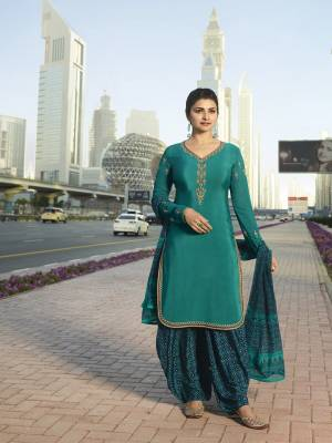 Add This Beautiful Designer Semi-Stitched Suit To Your Wardrobe In Shades Of Blue. This Pretty Suit Is In Teal Blue Color Paired With Navy Blue Colored Bottom And Dupatta. Its Top And Bottom Are Fabricated On Crepe Paired With Chiffon Dupatta.