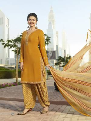 This Festive Season, Catch All The Attention Wearing This Designer Suit In Musturd Yellow Color Paired With Cream Colored Bottom And Dupatta. Its Top And Bottom Are Fabricated On Crepe Paired With Chiffon Dupatta. All Its Fabrics Ensures Superb Comfort All Day Long.