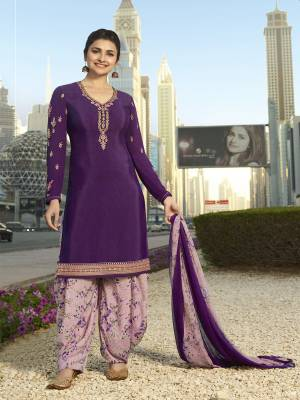 Bright And Visually Appealing Color Is Here With This Designer Suit In Dark Purple Colored Top Paired With Mauve Colored Bottom And Dupatta. Its Top And Bottom Are Crepe Fabricated Paired With Chiffon Dupatta. Buy Now.