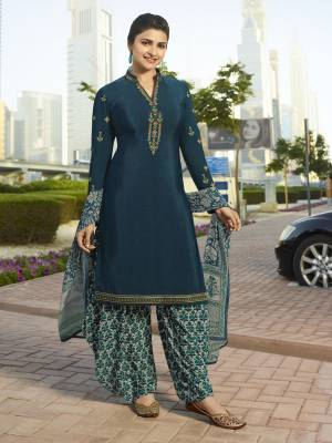 New Color Pallete Is Here With This Designer Suit In Prussian Blue Colored Top Paired With Contrasting Grey Colored Bottom And Dupatta. Its Top And Bottom Are Fabricated On Crepe Paired With Chiffon Fabricated Dupatta. Buy This Semi-Stitched Suit And Get This Stitched As Per Your Desired Fit And Comfort.