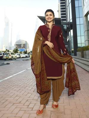 For A Royal Look, Grab This Designer Semi-Stitched Suit In Maroon Colored Top Paired With Contrasting Light Brown Colored Bottom And Dupatta. Its Top And Bottom Are Crepe Fabricated Paired With Chiffon Dupatta. Buy This Suit Now.