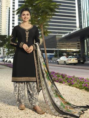 Enhance Your Personality Wearing This Designer Suit In Black Color Paired With White Colored Bottom And Dupatta. Its Top And Bottom Are Fabricated On Crepe Paired With Chiffon Dupatta. Its Fabrics Are Soft Towards Skin And Easy To Carry All Day Long.