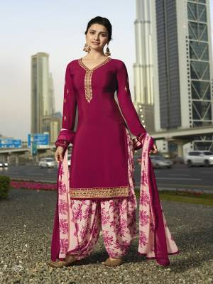 Bright And Visually Appealing Color Is Here With This Designer Suit In Dark Pink Colored Top Paired With Light Pink Colored Bottom And Dupatta. Its Top And Bottom Are Crepe Fabricated Paired With Chiffon Dupatta. Buy Now.