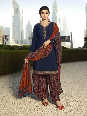 For A Bold And Beautiful Look, Grab This Designer Suit In Navy Blue Color Paired With Navy Blue Colored Bottom And Dupatta. Its Top And Bottom Are Crepe Based Paired With Chiffon Dupatta. It Is Light In Weight And Easy To Carry All Day Long.