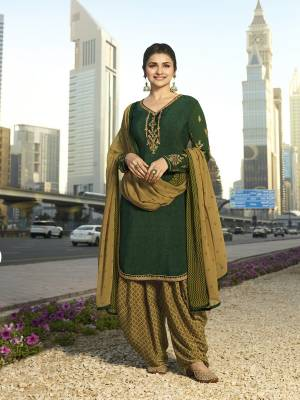 Add This Beautiful Designer Semi-Stitched Suit To Your Wardrobe In Shades Of Green. This Pretty Suit Is In Dark Green Color Paired With Pear Green Colored Bottom And Dupatta. Its Top And Bottom Are Fabricated On Crepe Paired With Chiffon Dupatta.