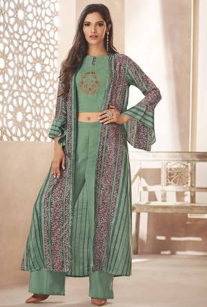 You Will Earn Lots Of Compliments Wearing This Designer Indo Western Set In Pretty Sea Green Color.  Its Top And Bottom Are Rayon Based Paired With Art Silk Fabricated Jacket. This Pretty Set Is Available In All Regular Sizes. Buy Now.