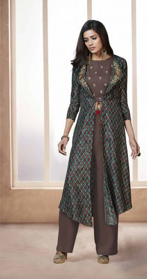 For Your College Party Or Any Occasion, Grab This Lovely Indo Western Set In Brown Colored Top And Bottom Paired With Multi Colored Jacket. Its Top And Bottom Are Fabricated On Rayon Paired With Linen Satin Fabricated Jacket. Its Fabrics Are Soft Towards Skin And Easy To Carry All Day Long.