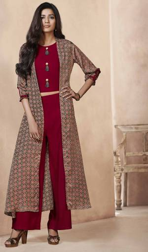 This Festive Season, Look The Most Amazing And Unique Of All Wearing This Designer Indo Western Set In Red Colored Top And Bottom Paired With Contrasting Grey Colored Jacket. Its Top And Bottom Are Fabricated On Rayon Paired With Linen Satin Fabricated Jacket. Its Fabric Is Light Weight And easy To Carry All Day Long.