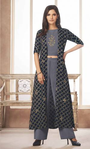Flaunt Your Rich And Elegant Taste Wearing This Designer Indo-Western Set In Grey Colored Top And Bottom Paired With Navy Blue Colored Jacket. Its Top And Bottom Are Rayon Based Paired With Linen Satin Fabricated Jacket. Its Color Pallete And Fabric Will Give A Rich Look To Your Personality.