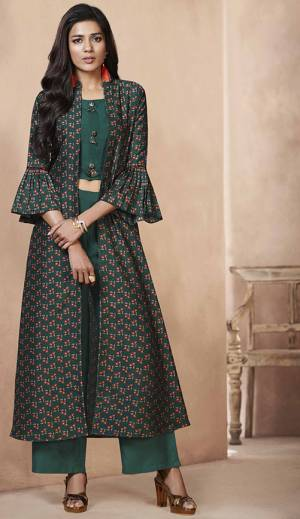 Add This Designer Indi-Western Set You Wardrobe Which You Can Style It As Per The Occasion. It Has Very Beautiful Pine Green colored Top And Bottom Paired With Printed Pine Green colored Jacket, Its Top And Bottom Are Fabricated On Rayon Paired With Art Silk Fabricated Jacket, Buy Now.