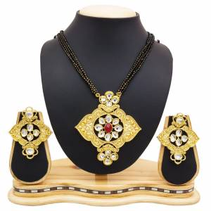 For A Heavy Look, Grab This Heavy designer Mangalsutra Set In Golden Color Beautified With Stone work. This Can Be Paired With Any Colored Heavy Ethnic Attire. Buy Now.