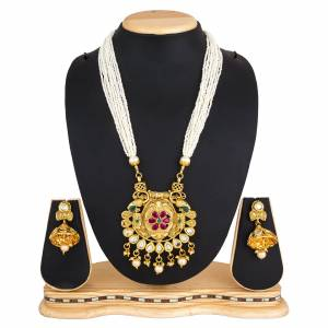 For A Queen Look, Here Is A Designer Royal Looking Necklace Set In Golden Color. This Necklace Set Can Be Paired With Heavy Ethnic Attire For More Enhanced Look. Buy Now