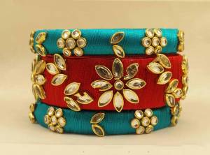 Here Is A Beautiful set Of contrasting Colored Bangles Made With Resham Thread And Stone Work. You Can Pair It Up With Either Of The Color From Both The Bagles. Also You Can Add Up With Pretty Simple Bagles To Make It As A Heavy Set.