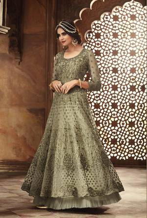 This Season Is About Subtle Shades And Pastel Play, So Grab This Heavy Deisgner Floo Length Suit In Pastel Green Color. Its Heavy Embroidered Top Is Net Based Paired With Santoon Bottom And Net Dupatta. Its Top Is Beautified With Heavy Resham Embroidery And Moti Work.