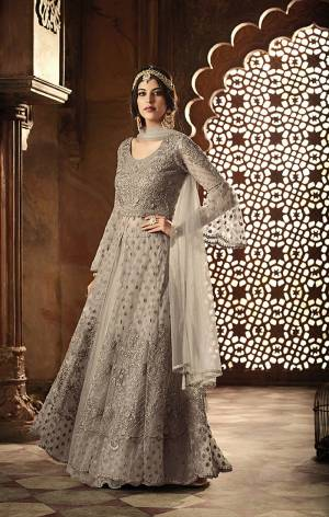 Flaunt Your Rich and Elegant Taste In This Elegant Grey Colored Designer Floor Length Suit. Its Heavy Embroidered Top IS Fabricated On Net Paired With Santoon Bottom And Net Fabricated Dupatta. Its Rich color And Heavy Embroidery Will Get you All The Atterntion.