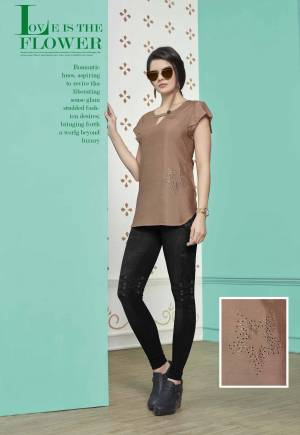 You Will Earn Lots Of Compliments Wearing This Designer Readymade Top In Light Brown Color Fabricated On Muslin Cotton. This Top IS Light Weight And Easy To Carry All Day Long.