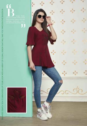 Grab This Readymade Top For Your College Wear, Work Place Or For An Outing. This Lovely Maroon Colored Top Is Fabricated On Muslin Cotton Which Is Light Weight And Easy To Carry All Day Long.